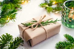 christmas presents natural decorations modern wrapped decor white background gifts boxes craft paper twine green 128142961